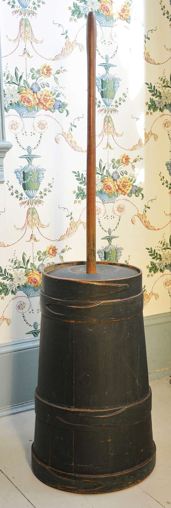 """An early 19th C. lapped butter churn in old green paint, 21""""H., 46"""" to the top of the handle"""