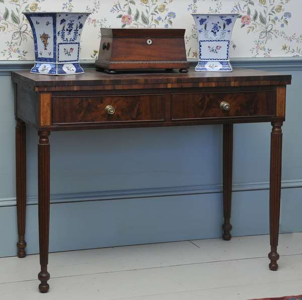 """A Federal mahogany two drawer games table flame birch inlaid panels on well formed reeded legs ca. 1810-1820 with period brass pulls, 29.5""""H, 36""""W."""