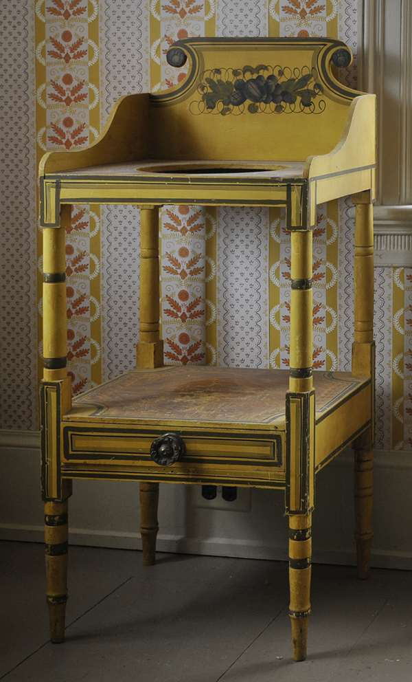 """A 19th C. New England paint decorated one drawer wash stand, polychrome painted in mustard, green, and black,38""""H"""