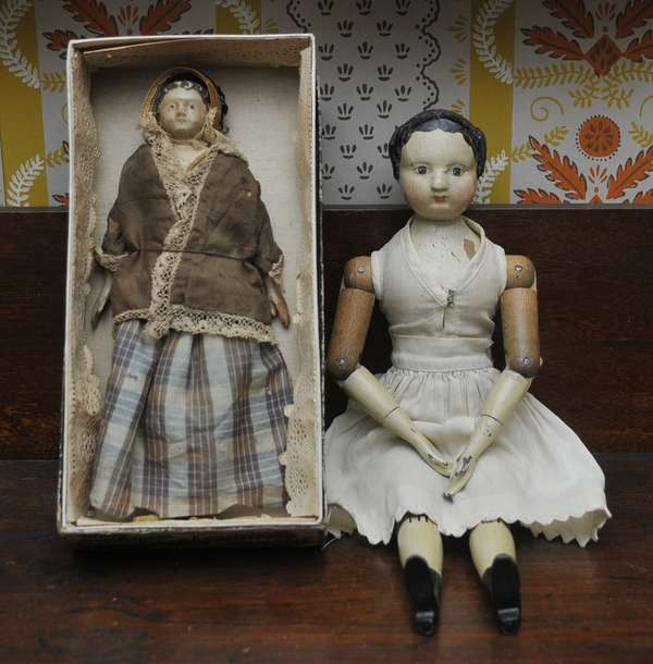"""Two 19th C. Dolls, 12"""" Joel Ellis made in Springfield VT, with pewter hands with another early 8"""" doll, both with period dress."""