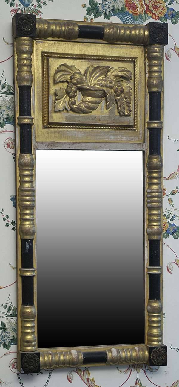 """A choice Federal, gilt split column wall mirror with applied carved cornucopia tablet with original finish. Label on reverse reads Sarah Cihall, ca.1830 13""""H."""