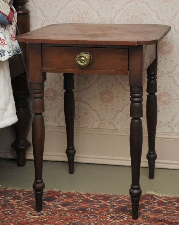 """Federal New Hampshire birch one drawer stand with bell turned leg, old color original pull, 27""""H."""