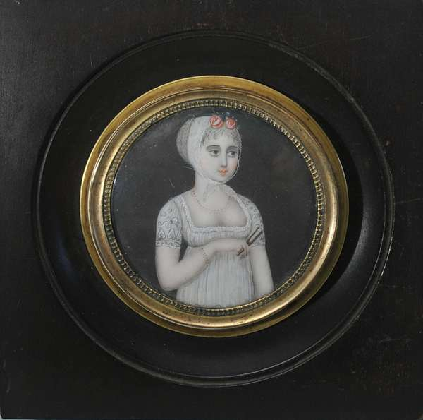 """A fine miniature painting on ivory of a young lady holding a fan, circular with 2"""" diameter ca.1800"""