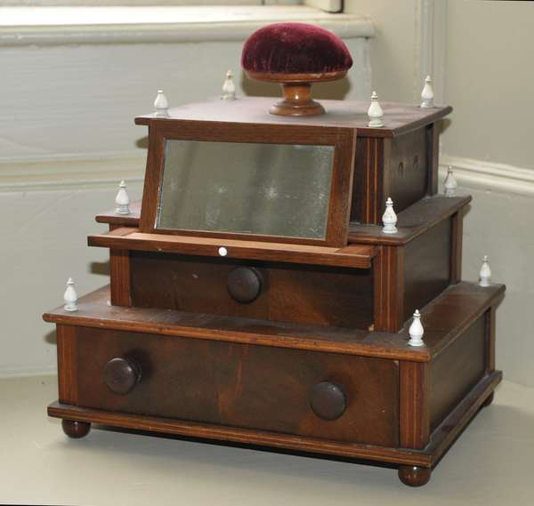 """A choice 19th C. inlaid mahogany sewing box likely made by a sailor for his wife with ivory mounts and pull out mirror apparatus, 9""""H. x 8""""W."""