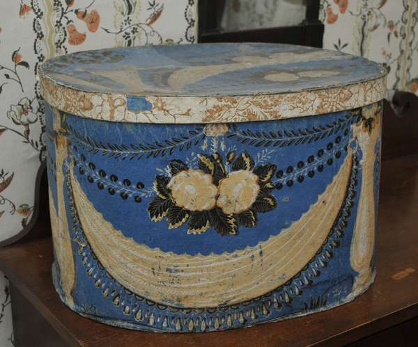 """A large 19th C. wall paper hat box, column and drape motif in blue signed in pencil Mrs. Kimball Merrill, New Hampshire, 12""""H. x 18""""L."""