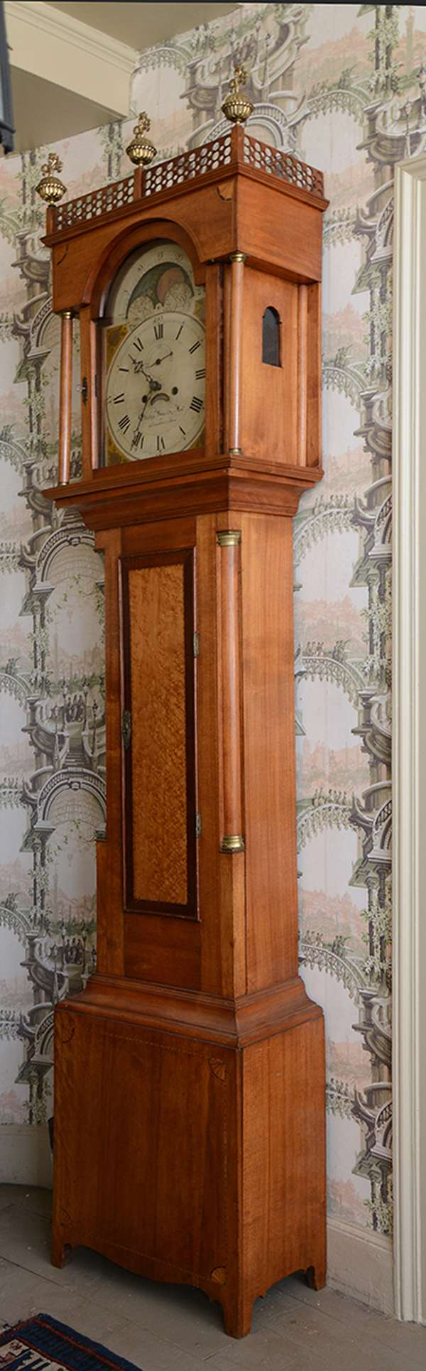 """A fine Federal New Hampshire grandfather clock birch case with birdseye and mahogany banded inlaid door, checkered and inlaid quarter fans, brass works dial signed Elisha Smith, Sanbornton, NH with period brass finials, 91""""H"""
