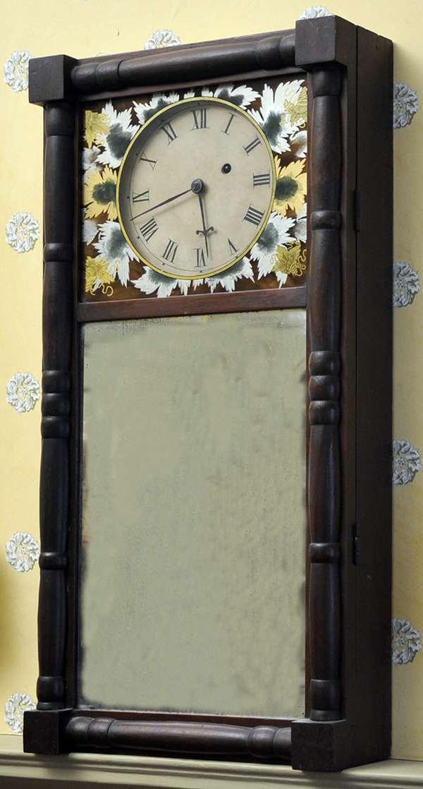 "A Federal New Hampshire mirror clock, original wagon wheel works, ca.1830. 28""H and 13.5""W."