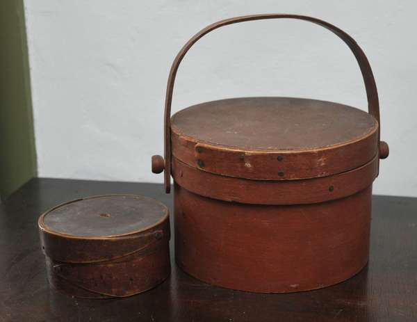 """Red painted 19th C. lapped swing handle bucket 7""""D. with a round red finger box, 4""""D."""