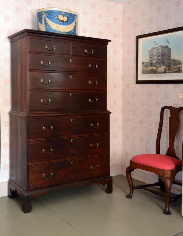 """A two part Chippendale cherry chest on chest with original brass and old red stain ca. 1780 chestnut secondary woods, 70""""H. x 38""""W. on top section"""