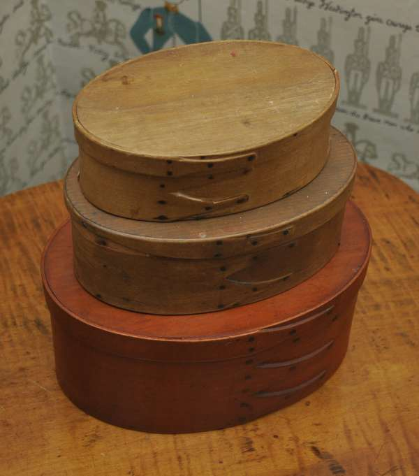 """Three 19th C. shaker finger boxes, graduated one in paint, 5.25""""L. to 7.5""""L."""