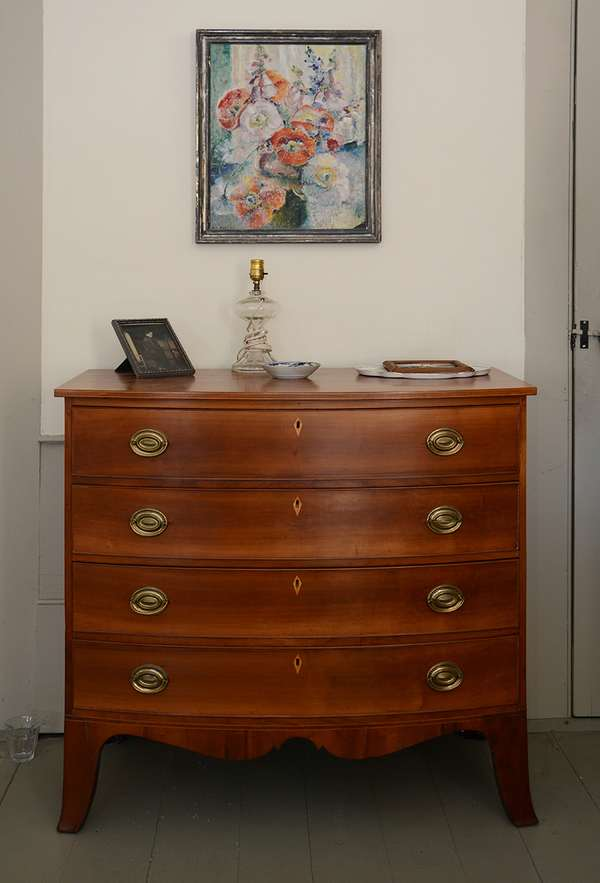 """A good Hepplewhite inlaid cherry bow front four drawer chest on high French feet ca. 1800-1810, 38""""W. x 38.5""""H."""