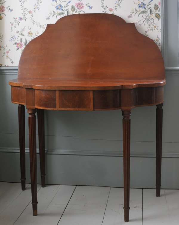 """A unique Federal cherry and mahogany five legged card table with delicate reeded legs, underside with chalk signature, 36""""L. x 30""""H."""