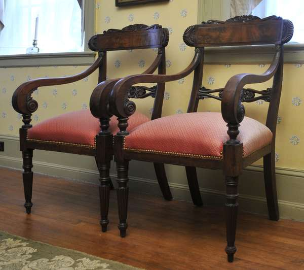 A pair of Federal, mahogany arm chairs, carved backs and arm supports on reeded legs, ca.1820