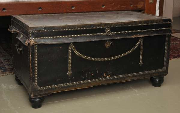 """A 19th C. China trade camphor wood trunk leather covered and brass bound on turned feet, 19""""H. x 35""""L. x 18""""D."""