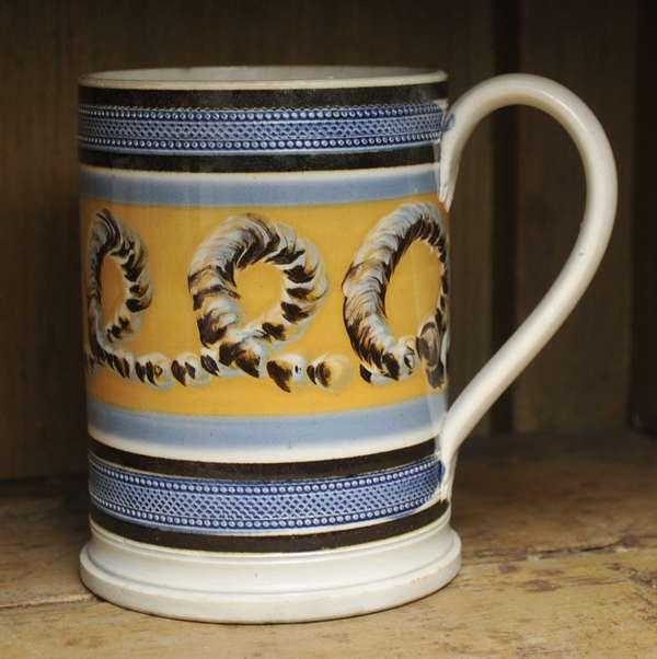 "An early 19th C. English pearlware mocha mug with earthworm decoration, 5.75""H."