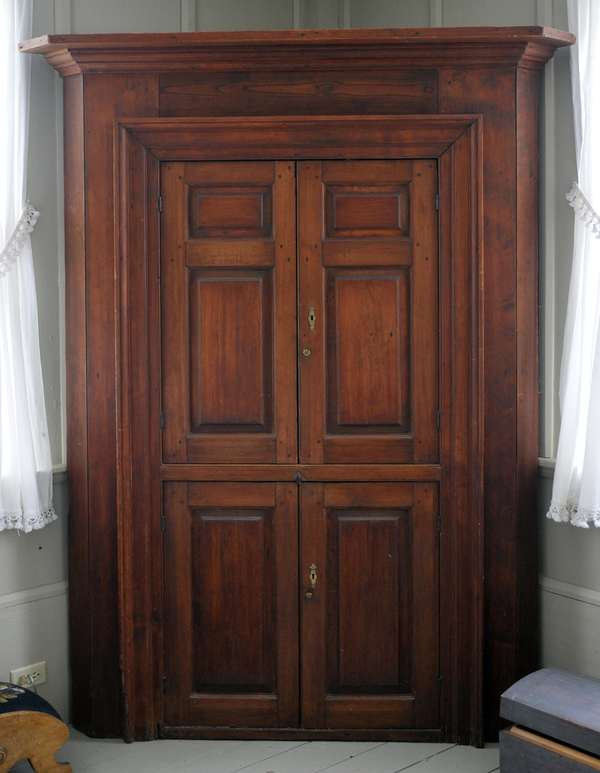 """18th C. barrel back corner cupboard with raised panel doors, picture frame moldings and old brass, 84""""H. x 57""""W."""