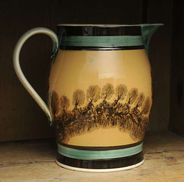 """An early 19th C. English pearlware pouring pitcher mocha seaweed decoration, 7.5""""H."""