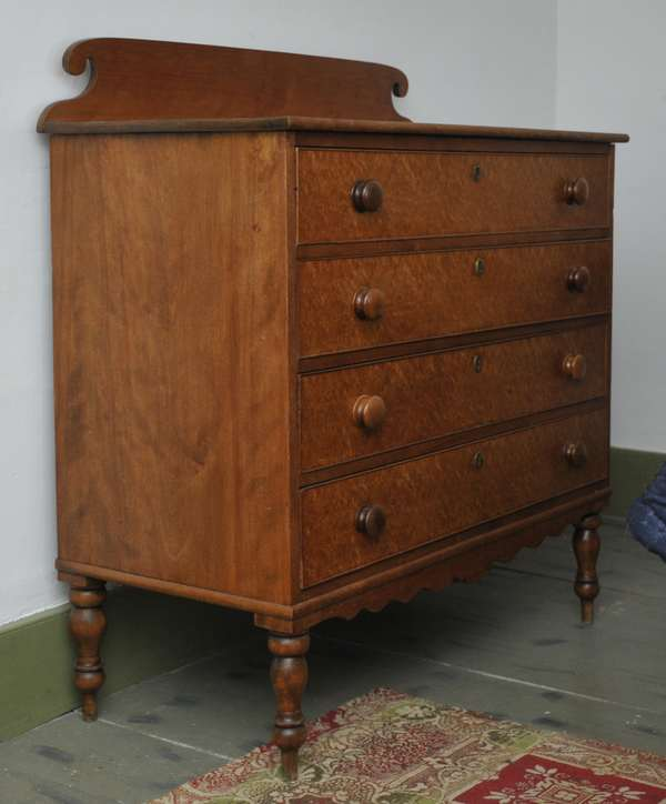 """A Federal NH birch and birdseye maple four drawer chest on turned legs, 39""""W x 45"""" to top of crest"""