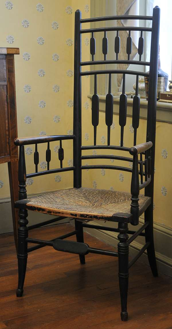 """An unusual form Sheraton arrow back, high back, fancy armchair in old black paint, ca.1830. Seat height is 16"""" and back height is 48""""."""