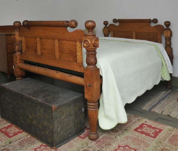 A good birch and birdseye maple cannonball four poster bed with acanthus carvings ca.1840