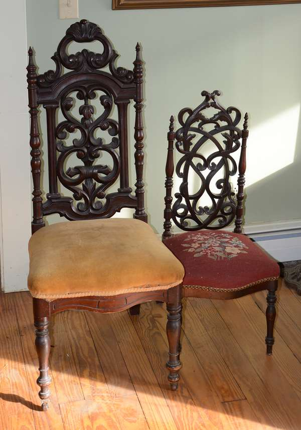 Two carved walnut Gothic chairs, one child's size (63-26)