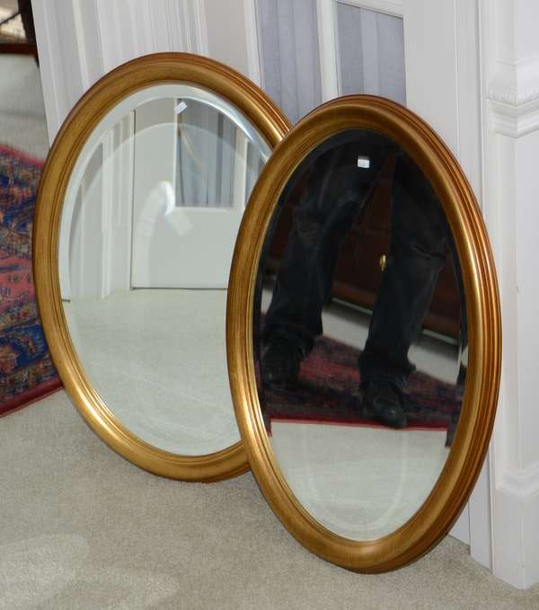 Pair of decorative oval wall mirrors (25-29)