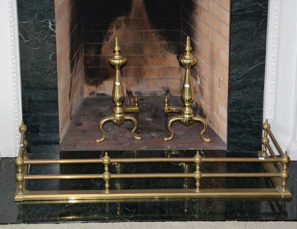 Pair of brass andirons with brass fender (25-36)