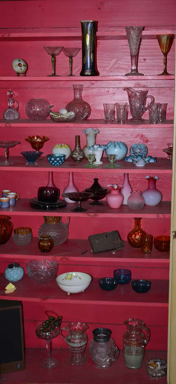 Second closet loaded with collectible glass including Tiffany wine glass, art glass vase and others (36)