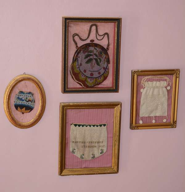 Several needlework/beaded purses, well presented in frames (72)
