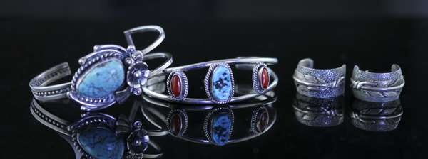 Three pieces of sterling: ben Begaye hoops along with two cuff bracelets (1-1)