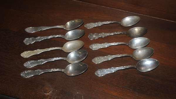 Ten sterling spoons (208-39)