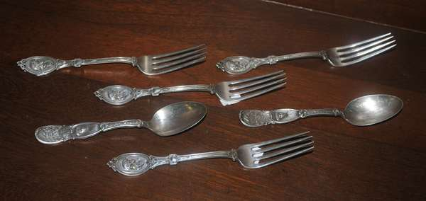 Six sterling medallion spoons and forks (208-54)