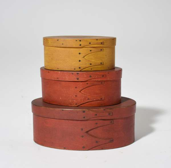 Nesting group of three early Shaker finger boxes in red and mustard paint, 5 - 25