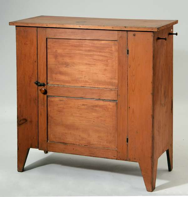 Shaker single door cupboard in salmon color, used in the infirmary Hancock, ca.1820-1840, 42
