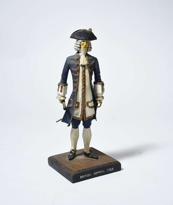 Antique Folk Art carved and painted figure of a British Admiral with sword holding a spy glass, 12