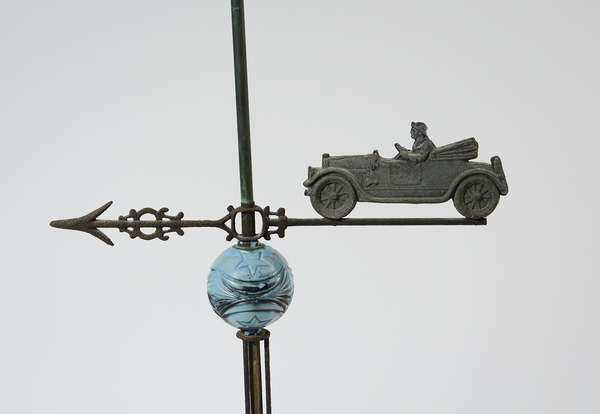 Antique lightning rod with early auto motif and blue glass ball