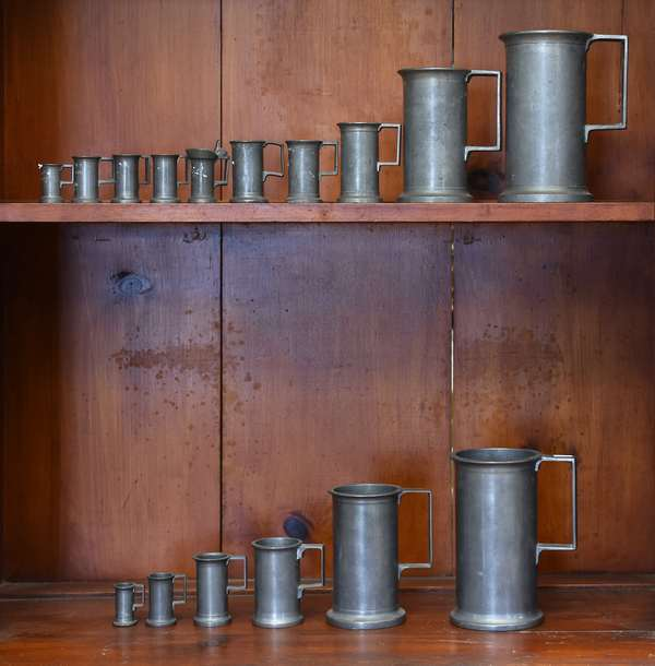 Sixteen pieces of antique pewter, including assembled graduated set of measures, 1.5