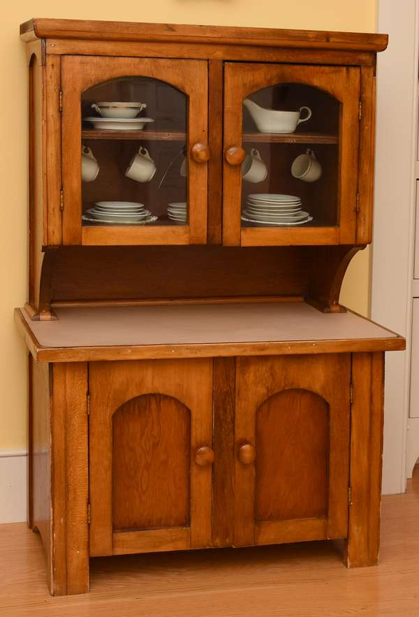 Child's size antique set-back kitchen cupboard with china set