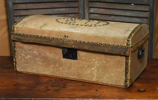 19th C. animal hide dome top trunk with brass stud detail, branded, 24