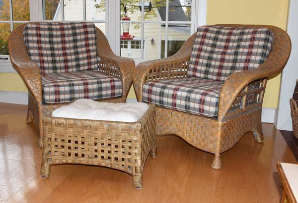 Pair of woven rattan club/armchairs with ottoman, three pieces