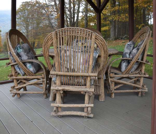 Rustic old hickory style bentwood patio set with four armchairs along with oval table