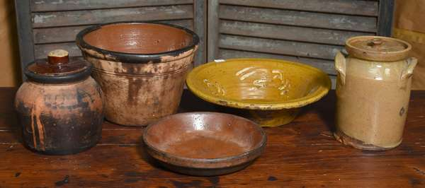 Lot of early redware and yellow ware vessels, five pieces total