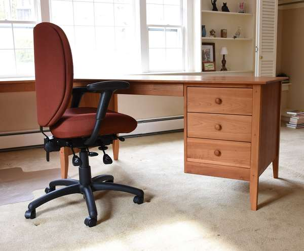 Pompanoosuc cherry flat top knee hole desk, along with swiveling office chair, 61