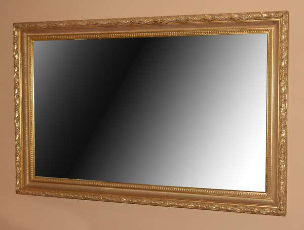 Very fine large size gesso and gilt beveled glass wall mirror, 68