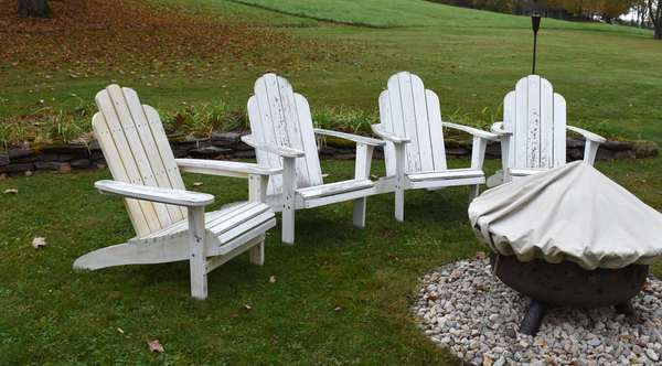 Four white painted Adirondack armchairs