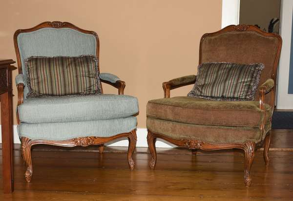 Pair of French style Bergeres/open armchairs with well carved frames in green and tan upholstery