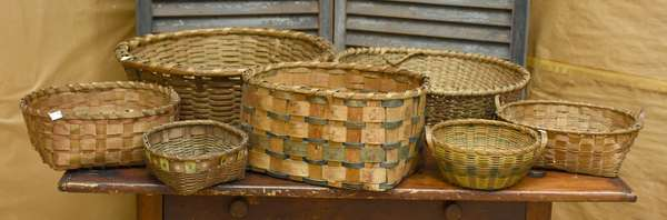Lot of seven splint baskets with dyed and potato stamp decorations, seven pieces total