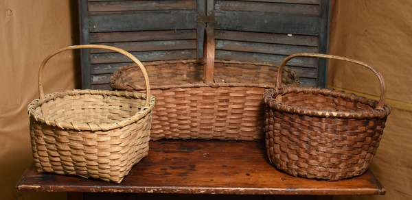 Three splint gathering baskets with wooden handles, three total