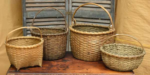 Grouping of four splint baskets, two with swing wood handles