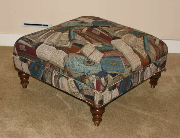 Unique upholstered ottoman with books motif, 29